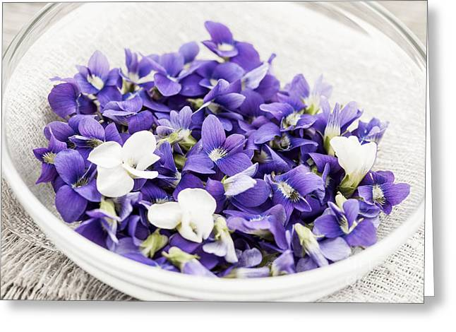 Organic Photographs Greeting Cards - Edible violets in bowl Greeting Card by Elena Elisseeva