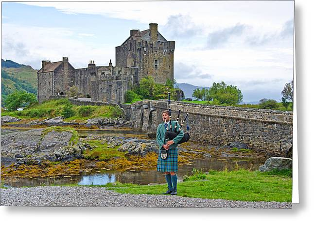 Eilean Donan Castle and the Lone Piper Greeting Card by Chris Thaxter