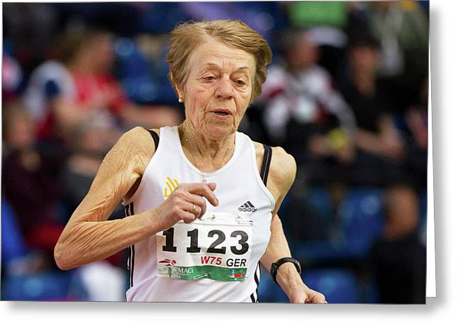 Elderly Female Athlete In Competition Greeting Card by Alex Rotas