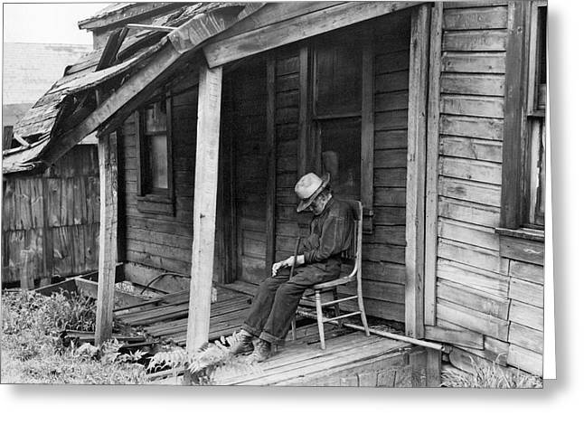Elderly Man Doses On His Porch Greeting Card by Underwood Archives