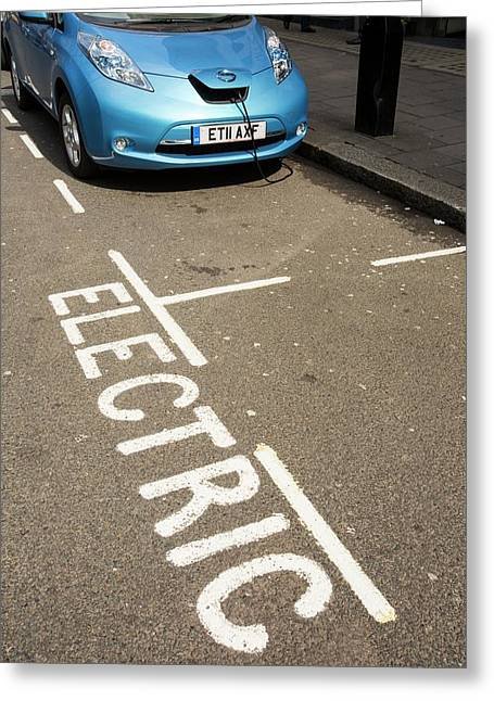 Electric Car At A Recharging Station Greeting Card by Ashley Cooper