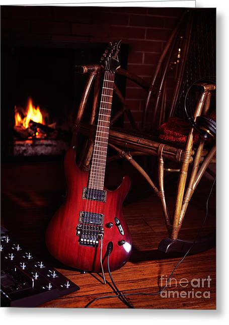 Indoor Still Life Greeting Cards - Electric guitar propped on chair near fireplace Greeting Card by Oleksiy Maksymenko