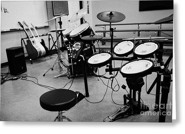 Drum Kit Greeting Cards - Electronic And Acoustic Drum Kit In A Music Training Room Greeting Card by Joe Fox