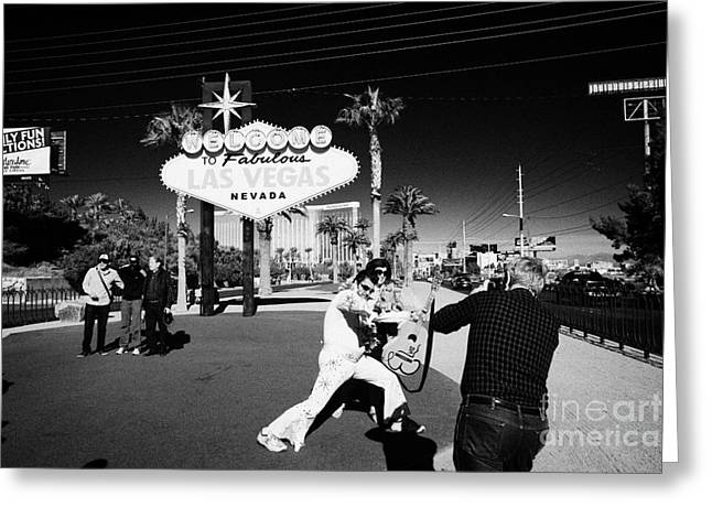 Tourist Trap Greeting Cards - elvis impersonator taking photos with tourists at the welcome to fabulous Las Vegas sign Nevada USA Greeting Card by Joe Fox