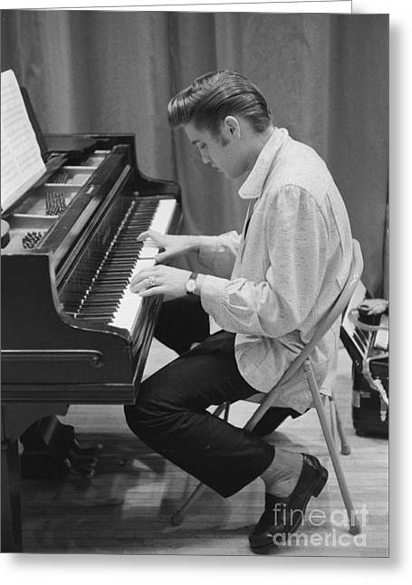 Stage Greeting Cards - Elvis Presley on piano while waiting for a show to start 1956 Greeting Card by The Phillip Harrington Collection