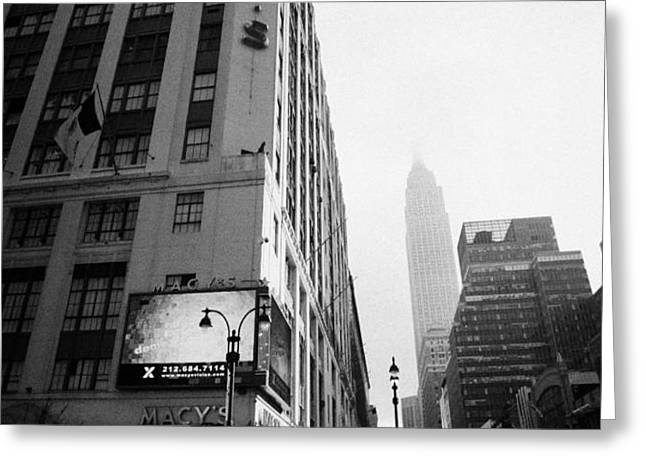 empire state building shrouded in mist as pedestrians crossing crosswalk on 7th ave new york Greeting Card by Joe Fox