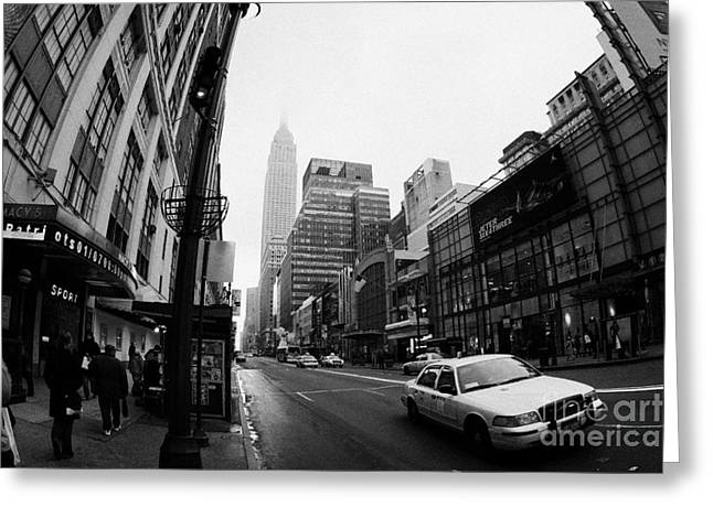 empire state building shrouded in mist as yellow cab taxi new york city Greeting Card by Joe Fox