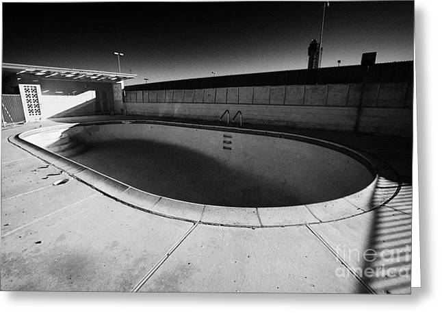 Empty Pool Greeting Cards - empty abandoned swimming pool at old motel on the strip Las Vegas Nevada USA Greeting Card by Joe Fox
