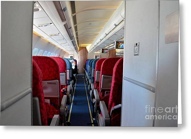 Empty Chairs Greeting Cards - Empty aircraft seats inside airplane cabin Greeting Card by Imran Ahmed