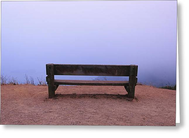 Parking Lots Greeting Cards - Empty Bench In A Parking Lot Greeting Card by Panoramic Images