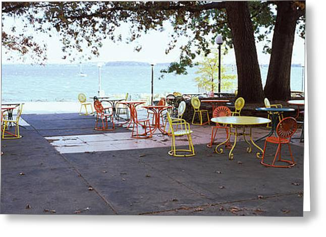 University Of Wisconsin Greeting Cards - Empty Chairs With Tables In A Campus Greeting Card by Panoramic Images