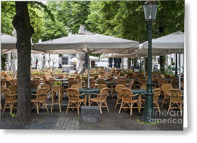 Empty Outdoor Cafe In Europe Greeting Card by Patricia Hofmeester