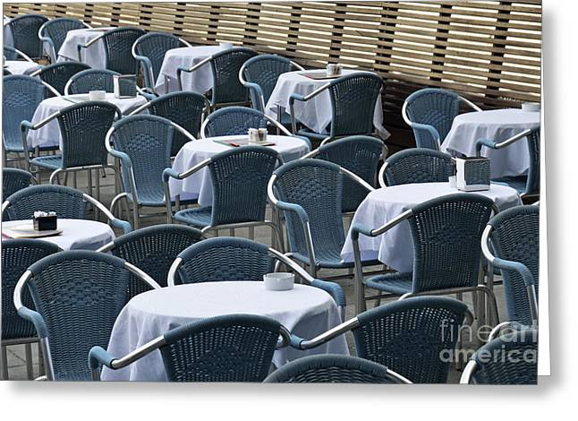 Empty Chairs Photographs Greeting Cards - Empty restaurant seats and tables Greeting Card by Sami Sarkis