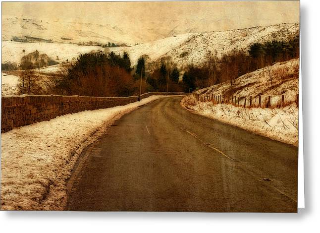 Harsh Conditions Photographs Greeting Cards - Empty road through snow covered Yorkshire moors Greeting Card by Ken Biggs