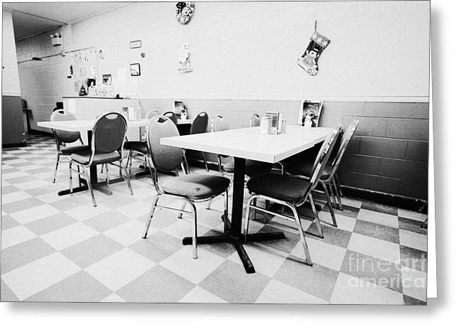 Empty Chairs Greeting Cards - empty tables in a small rural diner cafe in a town Saskatchewan Canada Greeting Card by Joe Fox