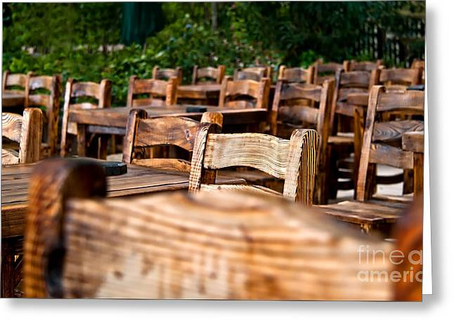 Empty Wooden Chairs And Tables Greeting Card by Leyla Ismet