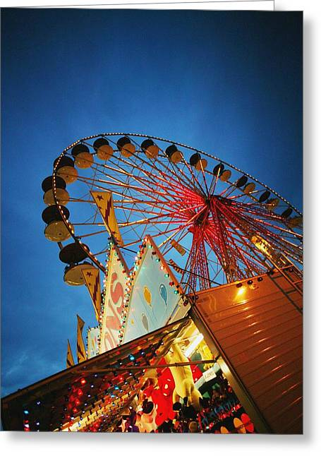 Rotate Greeting Cards - Evening At An Amusement Park Greeting Card by Darren Greenwood