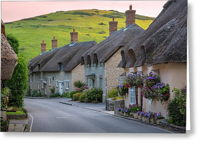 Evening View Of Thatch Roof Cottages Greeting Card by Brian Jannsen