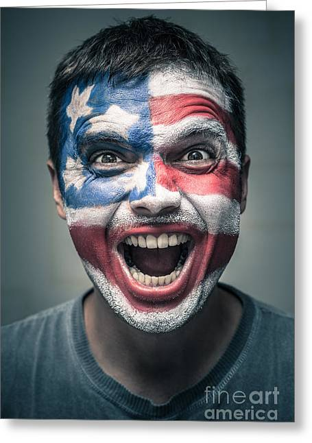 Spiteful Greeting Cards - Exited man with US flag painted on face Greeting Card by Jan Mika