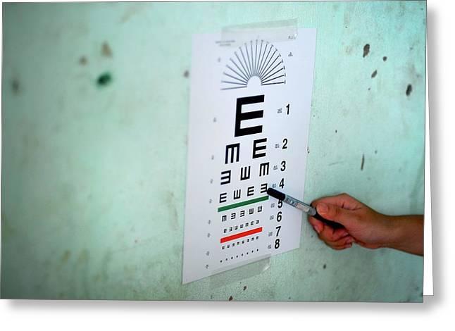 Eye Test During Humanitarian Exercise Greeting Card by Sara Csurilla