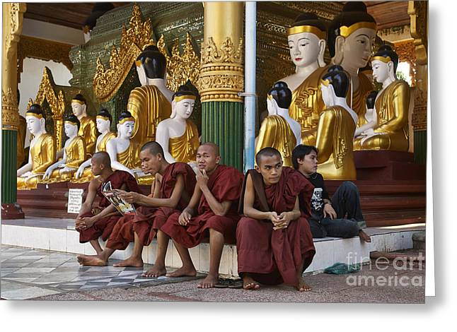 Figurs Greeting Cards - faithful Buddhist monks siiting around Buddha Statues in SHWEDAGON PAGODA Greeting Card by Juergen Ritterbach