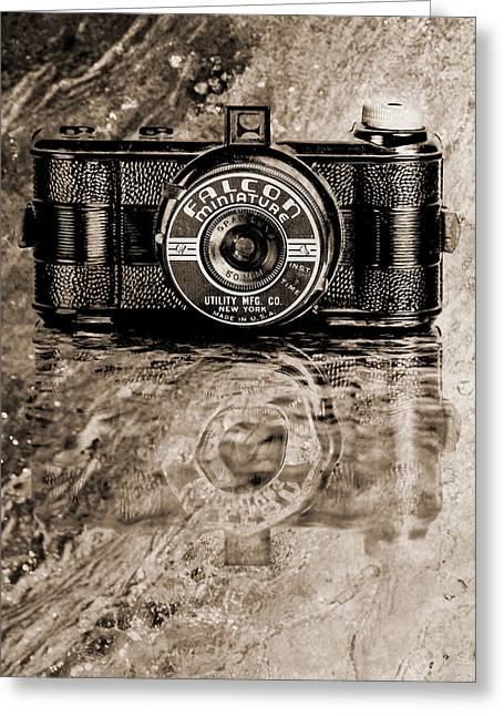 Falcon Miniature Camera With Water Greeting Card by Jon Woodhams