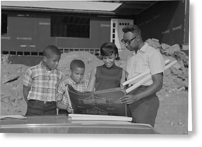Family Looking At Plans For New House Greeting Card by H. Armstrong Roberts/ClassicStock