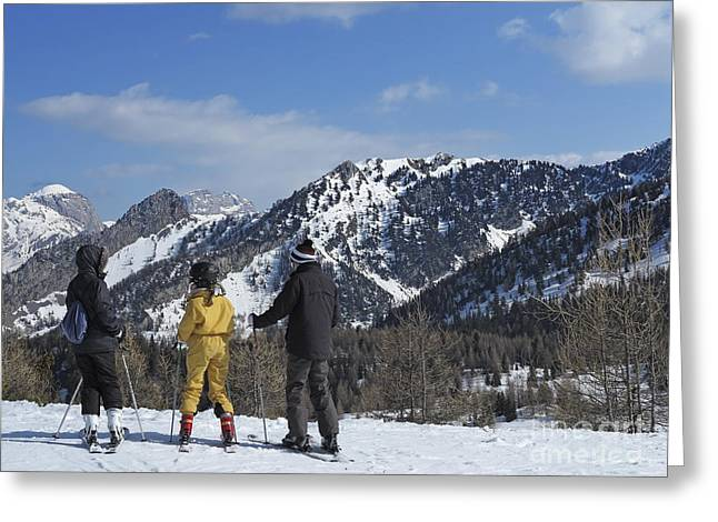 45-49 Years Greeting Cards - Family on ski contemplating mountains Greeting Card by Sami Sarkis
