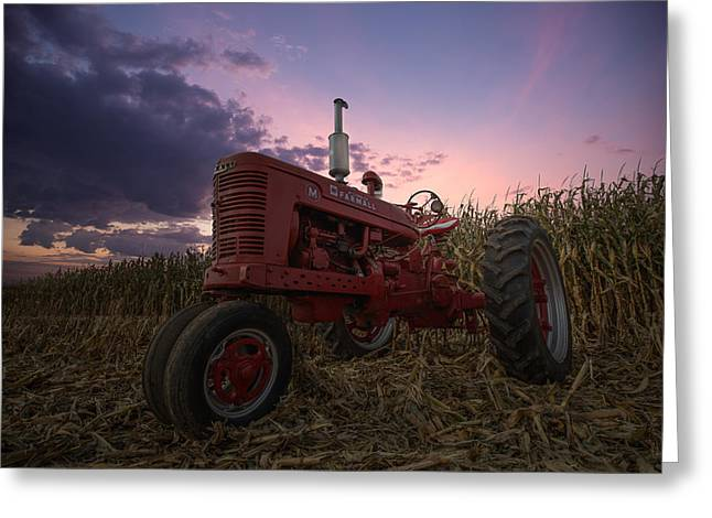 Cornfield Photographs Greeting Cards - Farmall sunset Greeting Card by Aaron J Groen