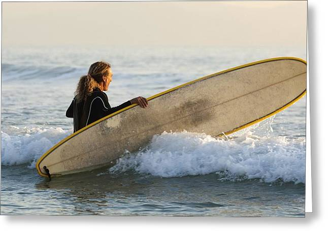 35-39 Years Greeting Cards - Female Surfer Wading Into Ocean With Greeting Card by Ben Welsh