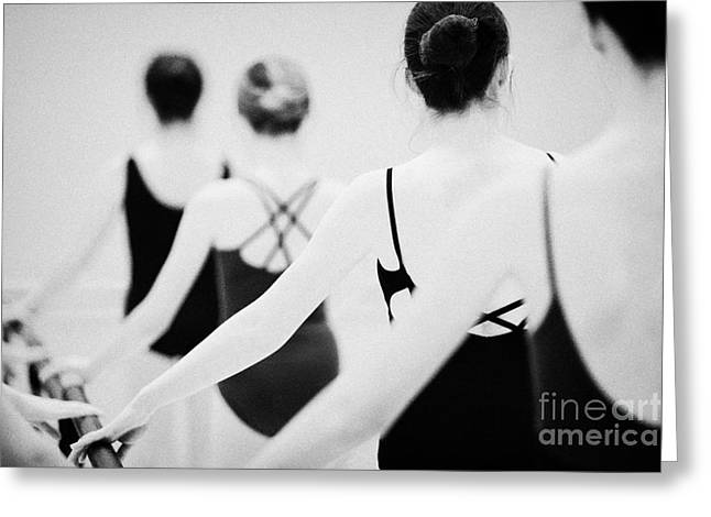 Teenage Photographs Greeting Cards - Female Teenage Ballet Students Holding On To A Ballet Barre At A Ballet School In The Uk Greeting Card by Joe Fox