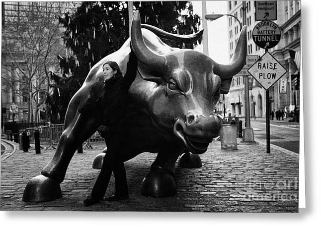 Manhaten Greeting Cards - female tourist at Charging Bull statue bronze sculpture bowling green park new york city Greeting Card by Joe Fox