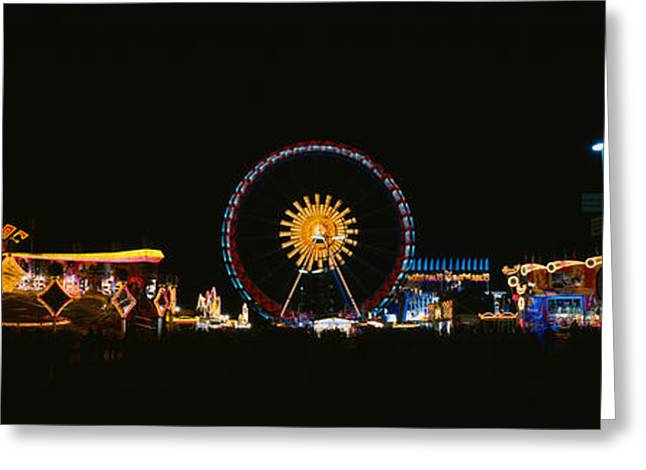 Amusements Greeting Cards - Ferris Wheel And Neon Signs Lit Greeting Card by Panoramic Images