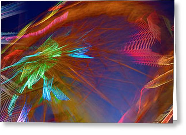 Ferris Wheel Night Photography Greeting Cards - Ferris Wheel Spinning At Night Greeting Card by Panoramic Images