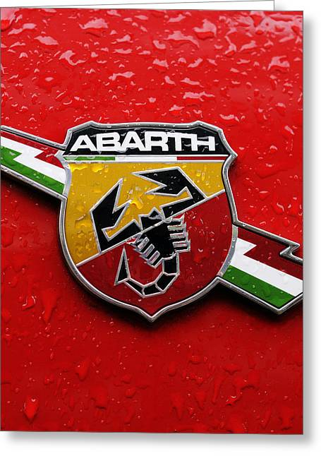Norman Pogson Greeting Cards - Fiat Abarth Badge On Red Greeting Card by Norman Pogson