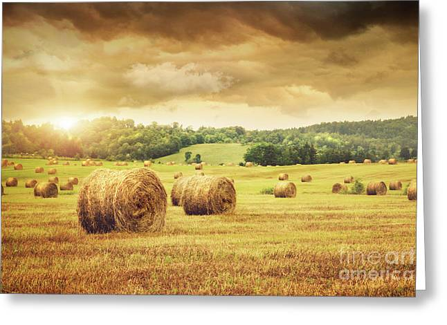Hayrick Greeting Cards - Field of freshly bales of hay with beautiful sunset Greeting Card by Sandra Cunningham