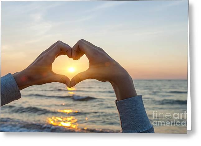 Framing Greeting Cards - Fingers heart framing ocean sunset Greeting Card by Elena Elisseeva