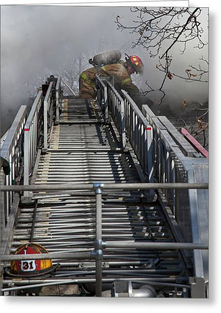 Firefighter On Telescopic Ladder Greeting Card by Jim West