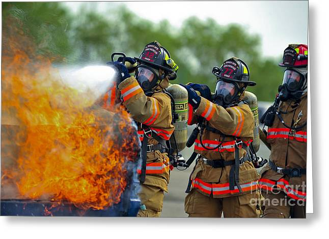 Dakota Faces Photographs Greeting Cards - Firefighters Put Out A Fire Greeting Card by Stocktrek Images