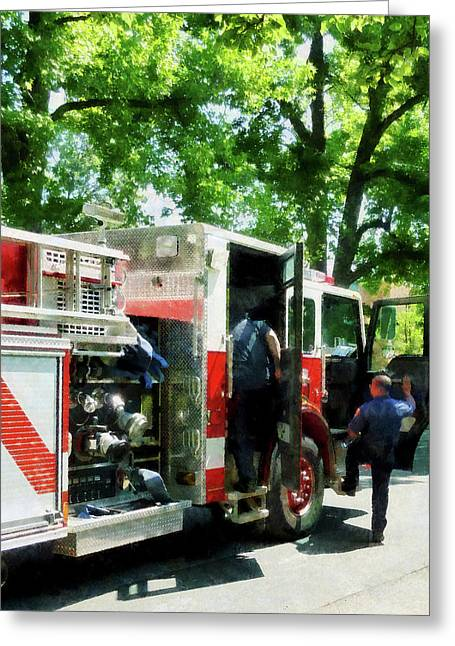 Fire Engine Greeting Cards - Fireman - Getting into the Fire Truck Greeting Card by Susan Savad