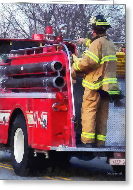Hose Greeting Cards - Fireman on Back of Fire Truck Greeting Card by Susan Savad