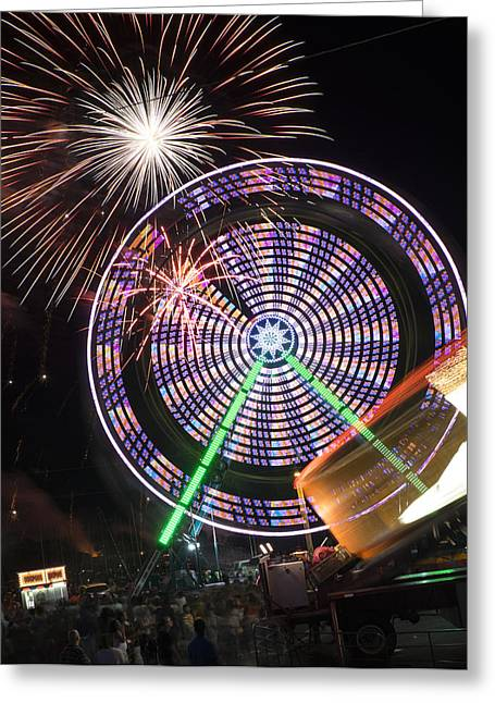 Rockets Red Glare Greeting Cards - Fireworks Bursting Over a Ferris Wheel Carnival Ride Greeting Card by John Franco