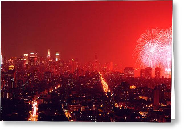 Fireworks Display Greeting Cards - Fireworks Display At Night Over A City Greeting Card by Panoramic Images