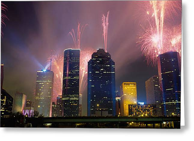 Haze Greeting Cards - Fireworks Over Buildings In A City Greeting Card by Panoramic Images