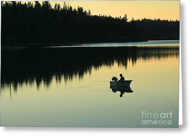 Fisherman at Dusk Greeting Card by Nancy Harrison