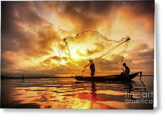 Entrapment Greeting Cards - Fisherman of Bangpra Lake in action when fishing Greeting Card by Anek Suwannaphoom