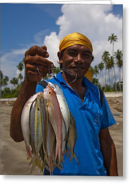 Livelihood Greeting Cards - Fisherman with catch in Indonesia Greeting Card by Science Photo Library
