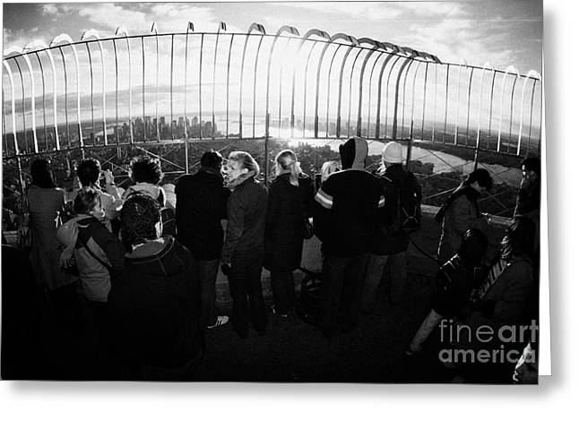 Fisheye Shot Of Sightseers Look At The View From Observation Deck 86th Floor Empire State Building Greeting Card by Joe Fox