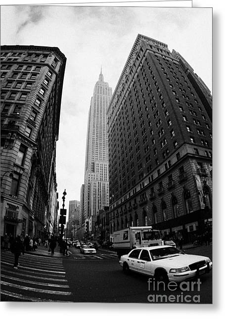 Fisheye Shot Of Yellow Cab And Empire State Building At Intersection Of 34th Street Broadway 6th Greeting Card by Joe Fox
