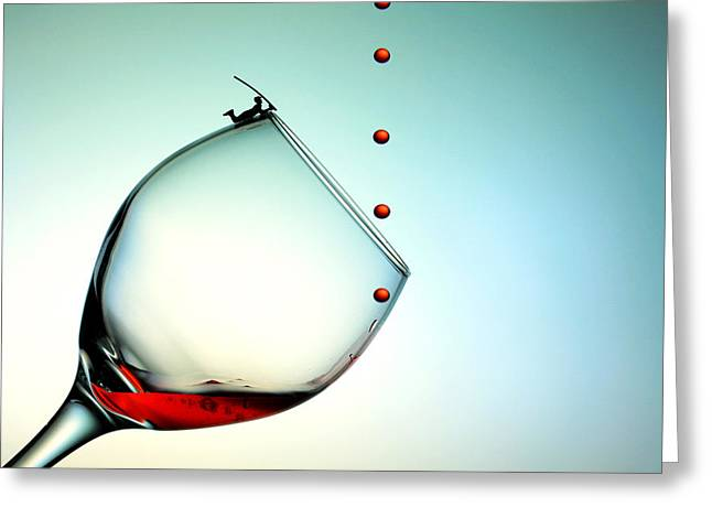 Big Wine Greeting Cards - Fishing on a glass cup with red wine droplets little people on food Greeting Card by Paul Ge
